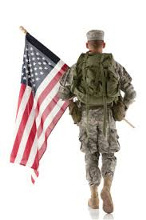 Soldier walking with an American Flag